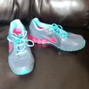 Aqua and pink reax running Nike's tennis shoes 8